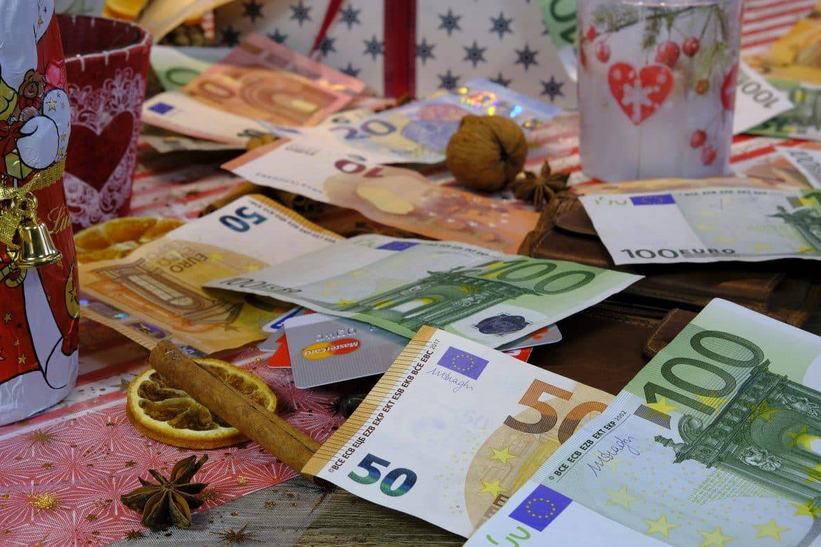 money spread on the table for expensive gifts