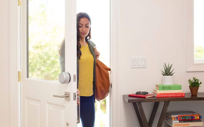 Woman Opening A Door With Smart Lock