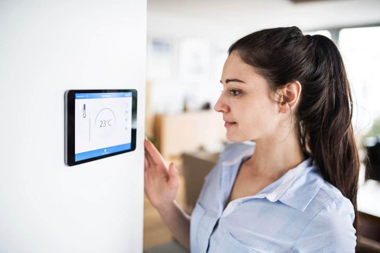 Girl Adjusting A Best Smart Thermostat