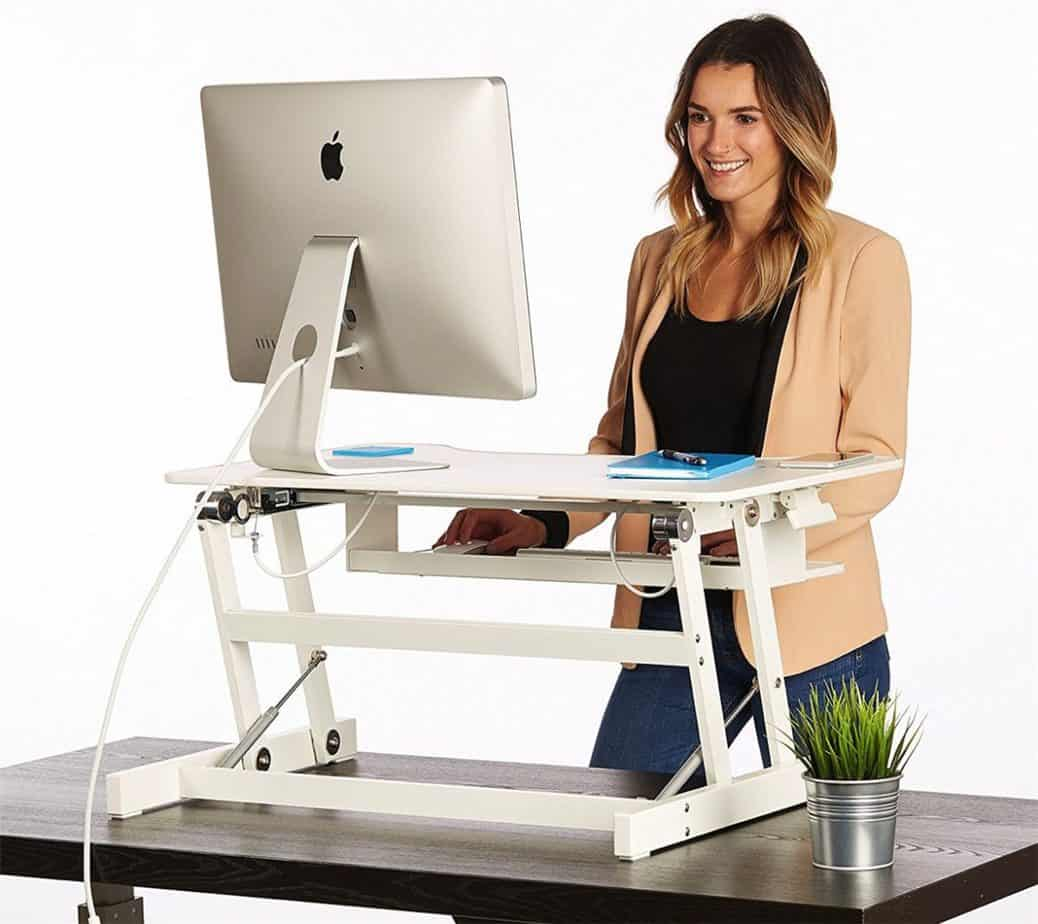 Woman in front of a standing desk