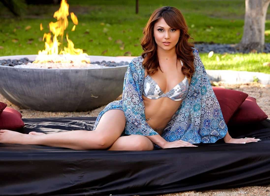 Attractive woman in front of a fire pit