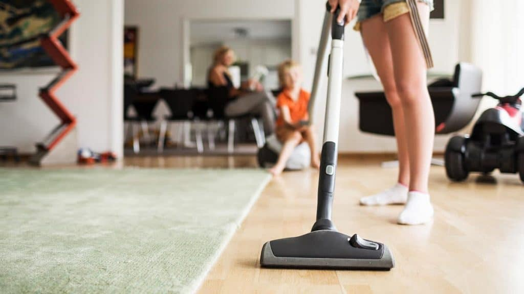 Woman Vacuuming With A Stick