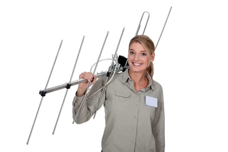 Woman carrying Long Range TV antenna