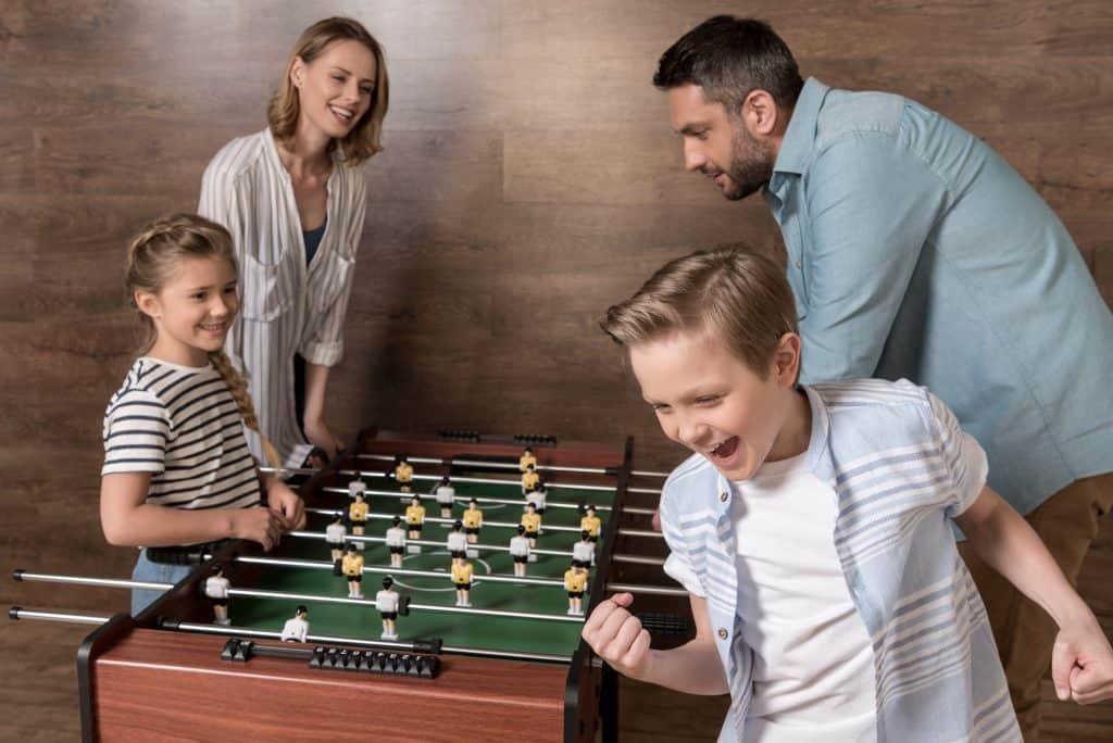 Kid Enjoying Foosball With His Family!