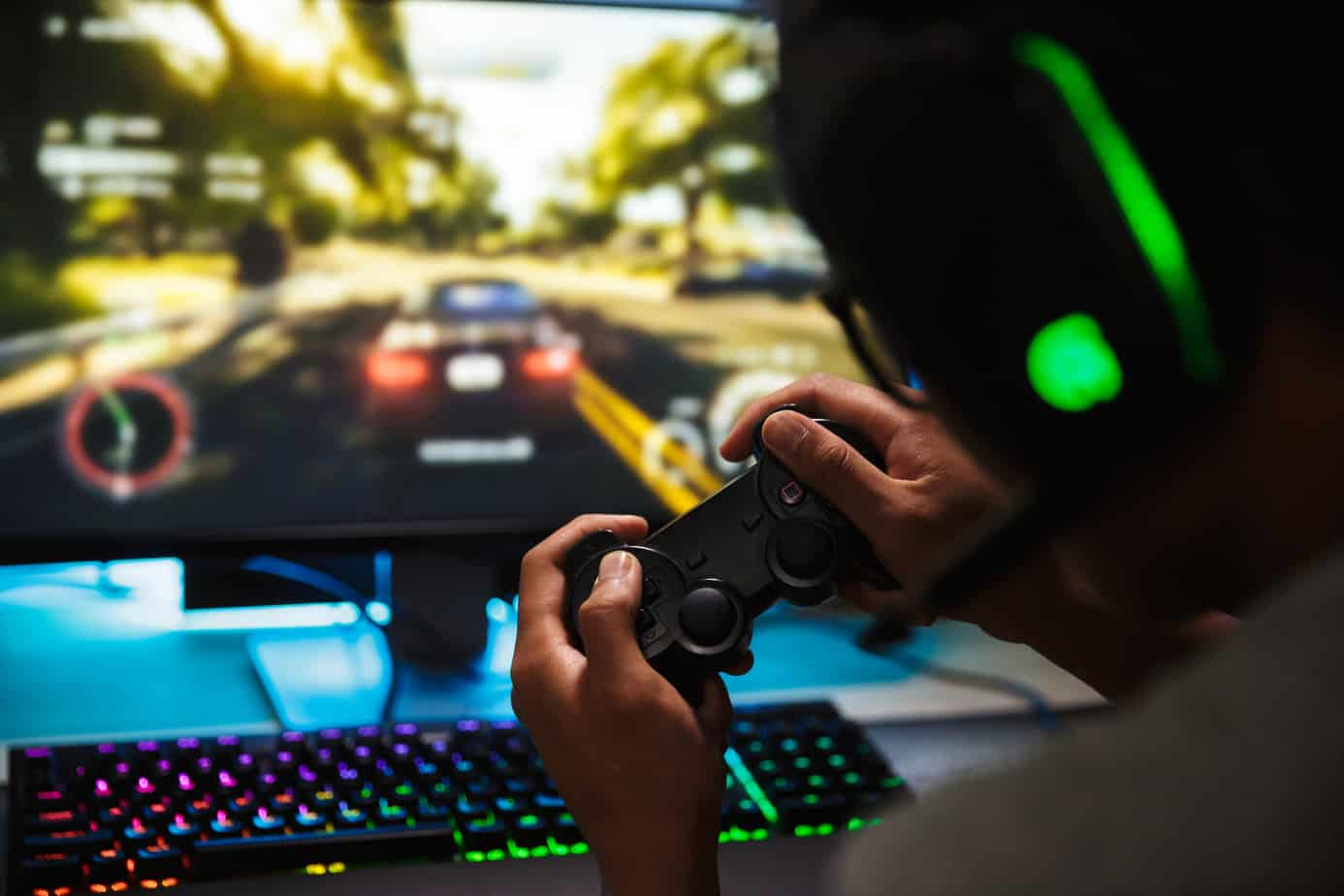 Photo closeup of teenage gamer guy playing video games online on