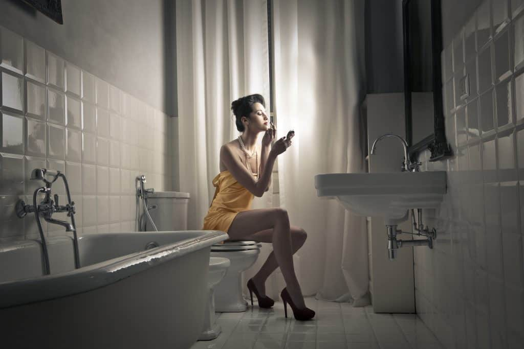 Woman wearing lipstick on bidet