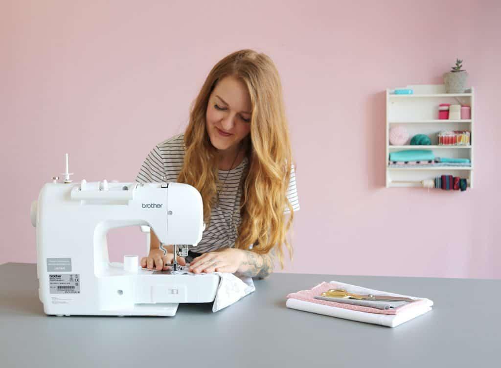 Woman Stitching on Brother Machine
