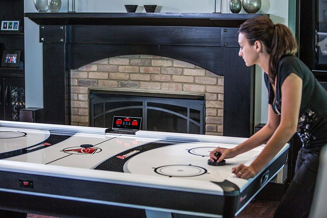 Woman Playing On Air Hockey table