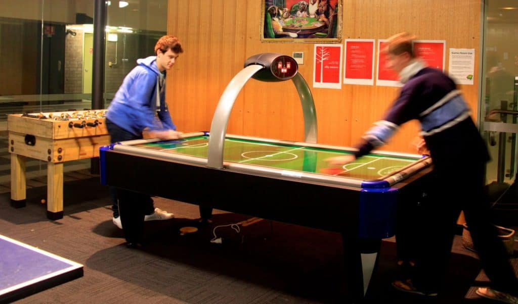 Boys Playing Air Hockey