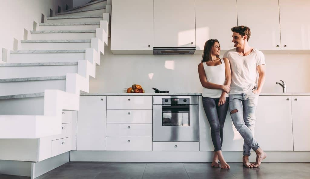 Couple on kitchen with Broan RangeHood