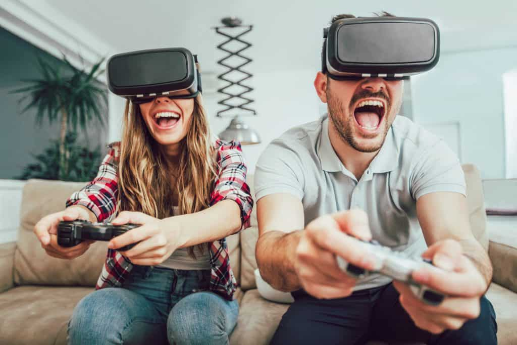 Young funny couple playing video games virtual reality glasses i