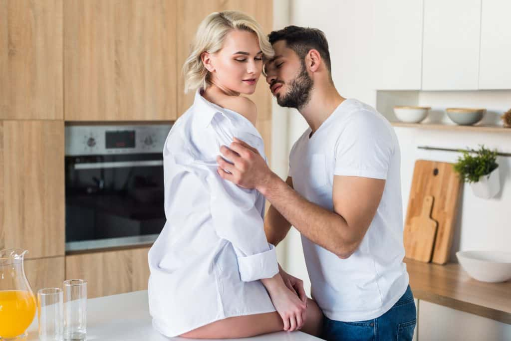 Couple in Kitchen In The Morning