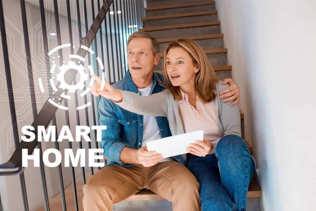 Couple On Stairs In A Smart Home