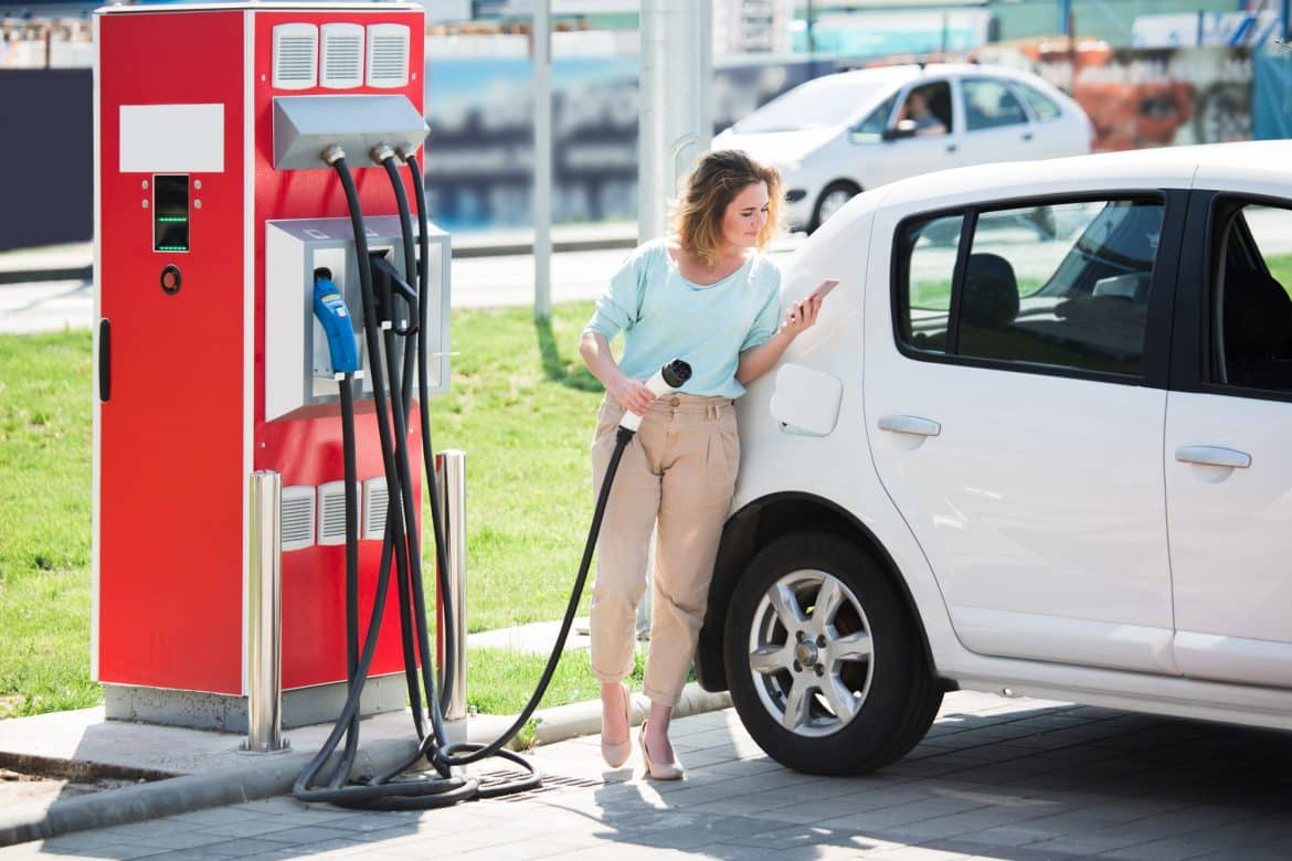 Woman With An Electric Car