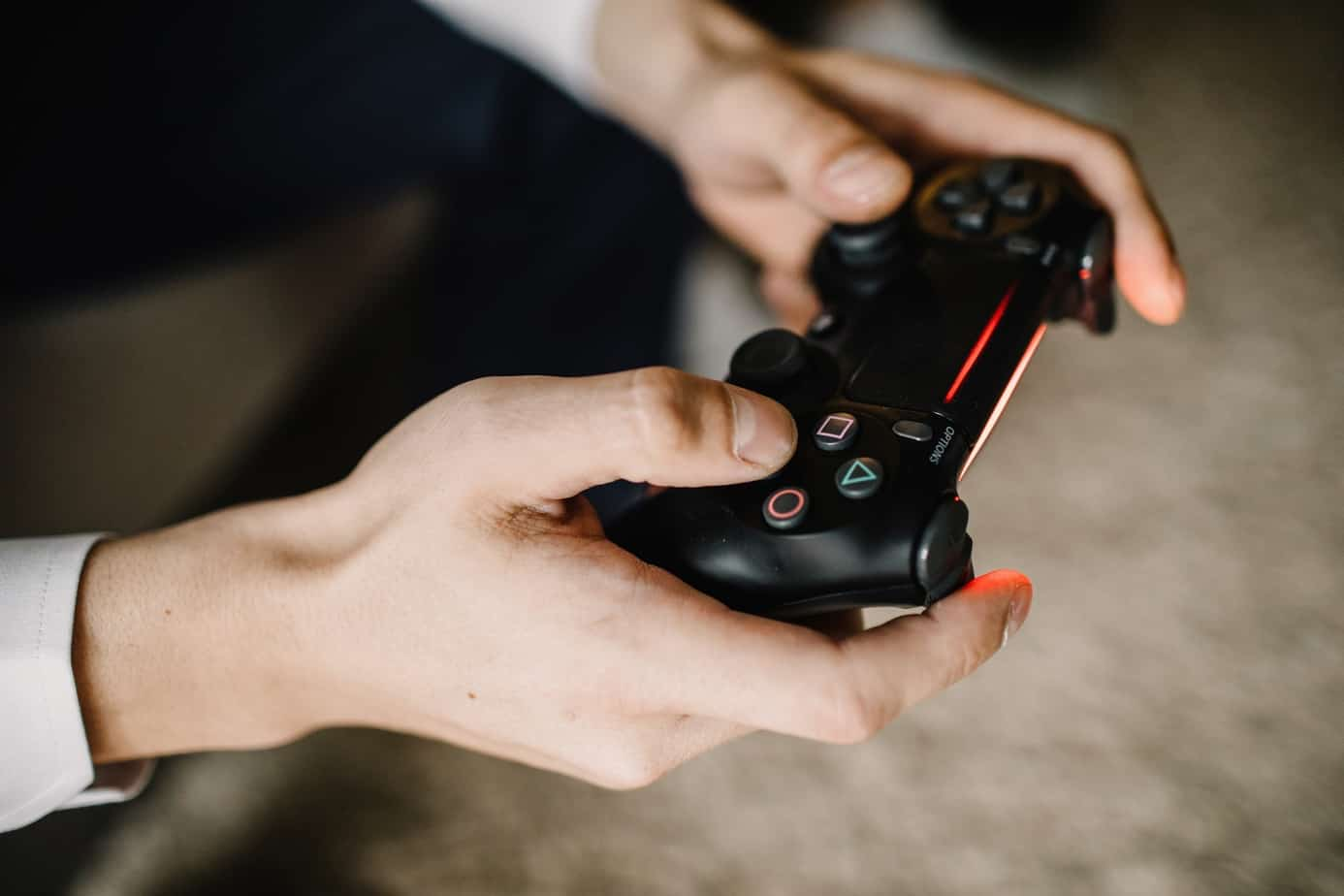 male Hands With PS4 Controller