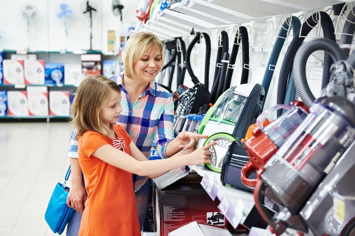 Mother and daughter shopping for kirby electric vacuum cleaner