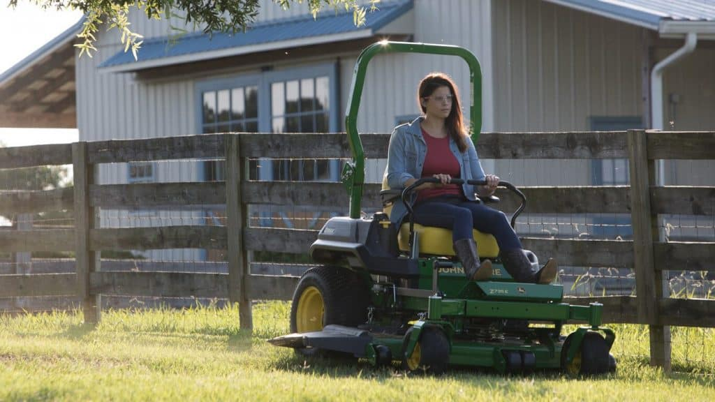Woman riding on Lawn Mower