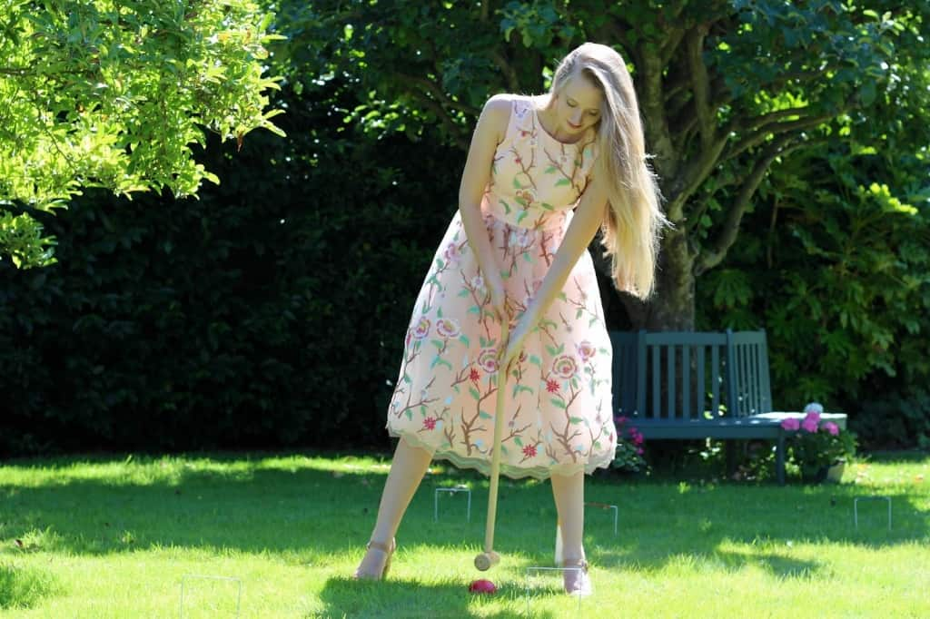 Girl taking a croquet shot