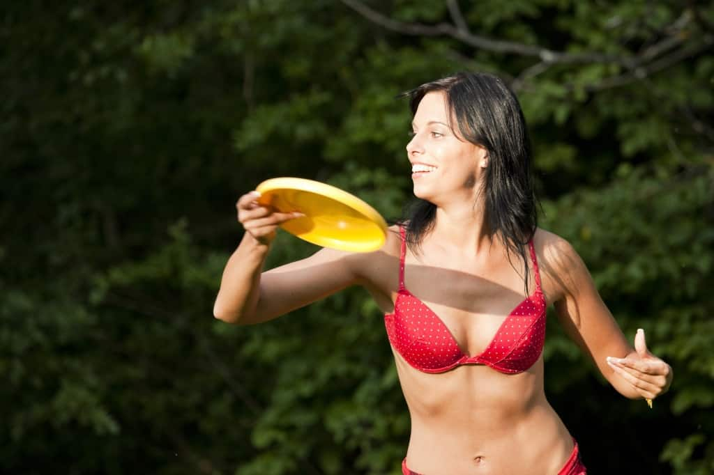 Beautiful woman with frisbee