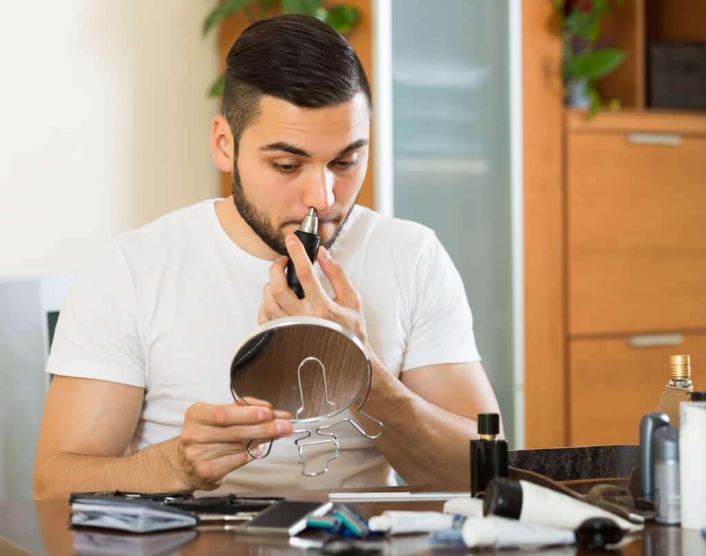 Man With A Nose Hair Trimmer