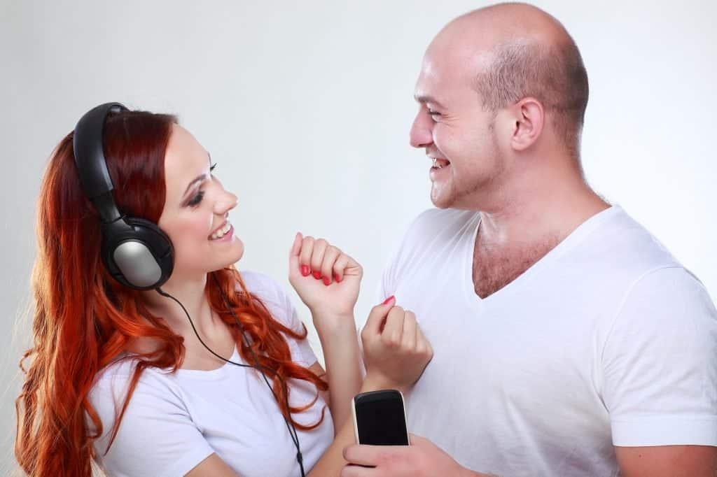 Couple sharing headphones