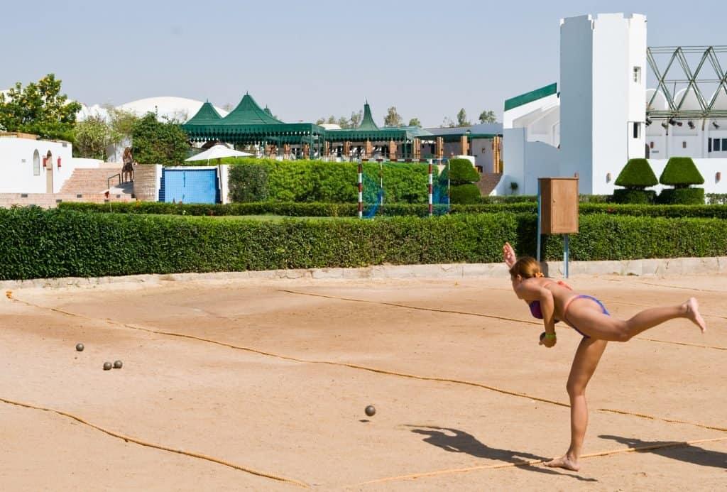 woman playing bocce ball