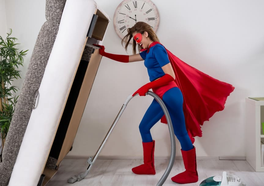 super hero vacuuming floor
